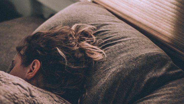 Woman using sleep tracker